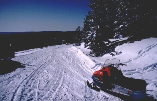 snowmobile on the side of trail
